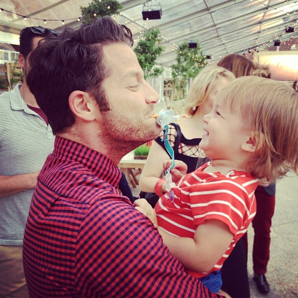 Rebecca Minkoff snapped a cute photo of Nate Berkus spending time with her son, Luca, at the Target FEED event. Source: Instagram user rebeccaminkoff