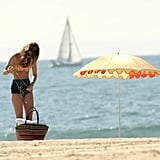 AnnaLynne McCord brought along her iPod to the beach.