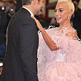 Gaga returned the favour by helping Bradley with his suit. That's what friends are for, right?