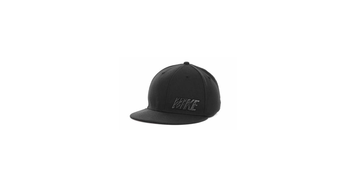 06a4341bfa0 Go way back in this retro Nike fitted cap — we especially love the ...