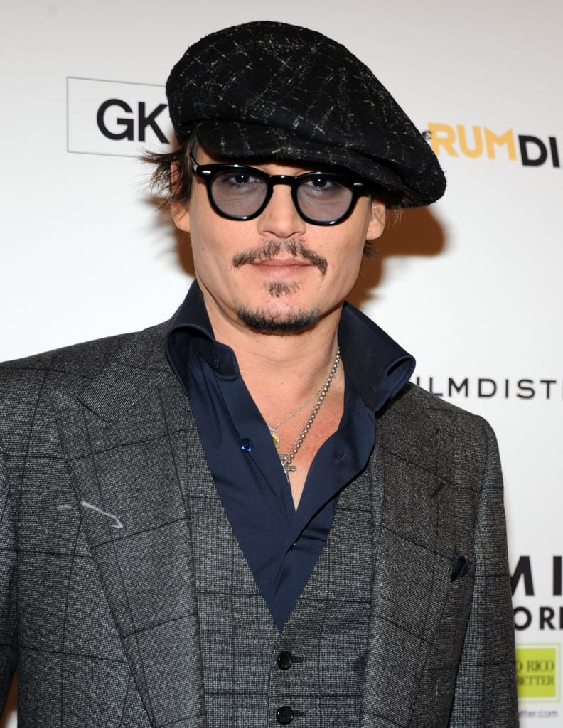 Johnny Depp smiled for a photo.