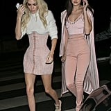 Gigi and Kendall stepped out for Olivier Rousteing's Balmain party bash wearing sugar-pink looks that debuted hours earlier on the Fall '16 runway. Gigi chose a striped bodysuit, matching duster coat, and high-waisted pants.