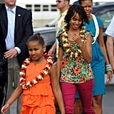 Michelle arrived with her daughters at the Hickam Air Force Base in Honolulu, HI, for their Christmas vacation in 2009.