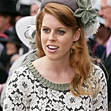 Princess Beatrice matched the khaki flower in her hat to her lace dress.