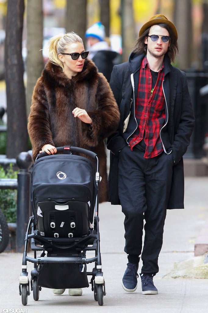 Sienna Miller and Tom Sturridge took Marlowe Sturridge for a walk.