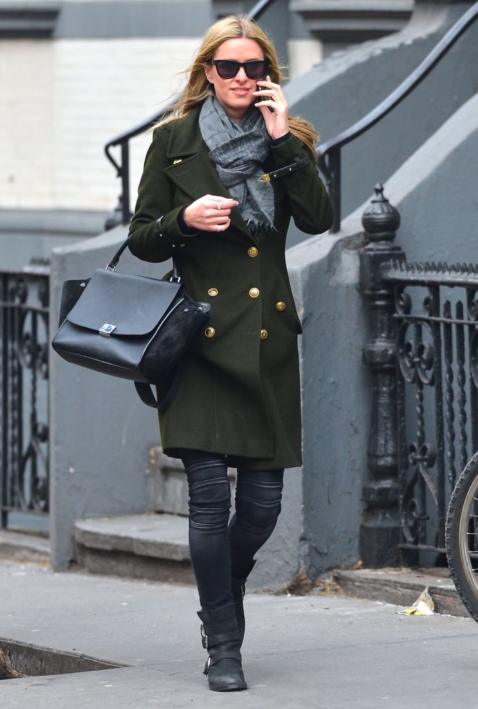Nicky Hilton strolled the streets of NYC in a green military-style coat, motorcycle-inspired jeans, and a black Céline tote.