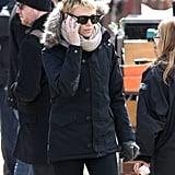 Charlize Theron chatted on her phone.