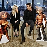 Emma Stone and Ryan Reynolds posed with cardboard versions of their characters from The Croods.