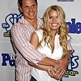 Nick pulled Jessica in as they posed for photographers in May 2003.