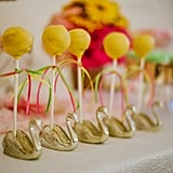 Cake pops were placed in swan cigar holders on the dessert table.