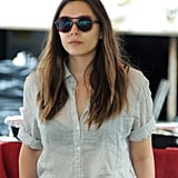 Elizabeth Olsen was dressed in a button-down and high-waisted pants on the set of Very Good Girls.