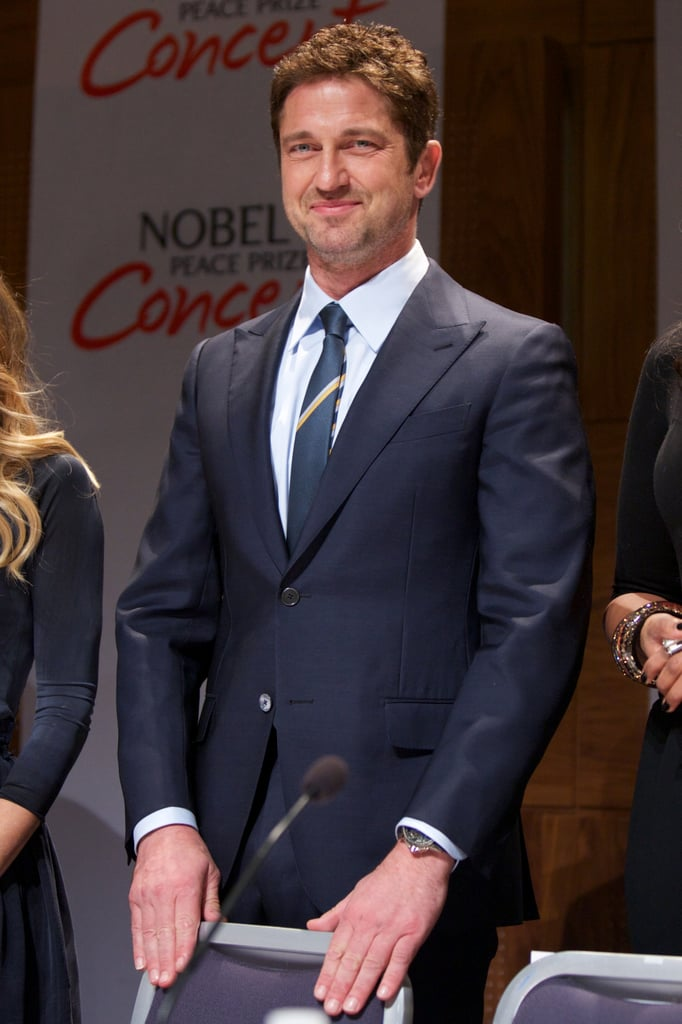 Gerard Butler wore a blue suit to a press conference ahead of the Novel Peace Prize Concert in Oslo.