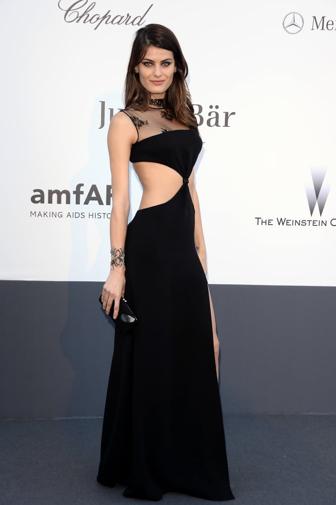 Isabeli Fontana dared to wear a black lace cutout Redemption Choppers gown with a cool spider cuff.