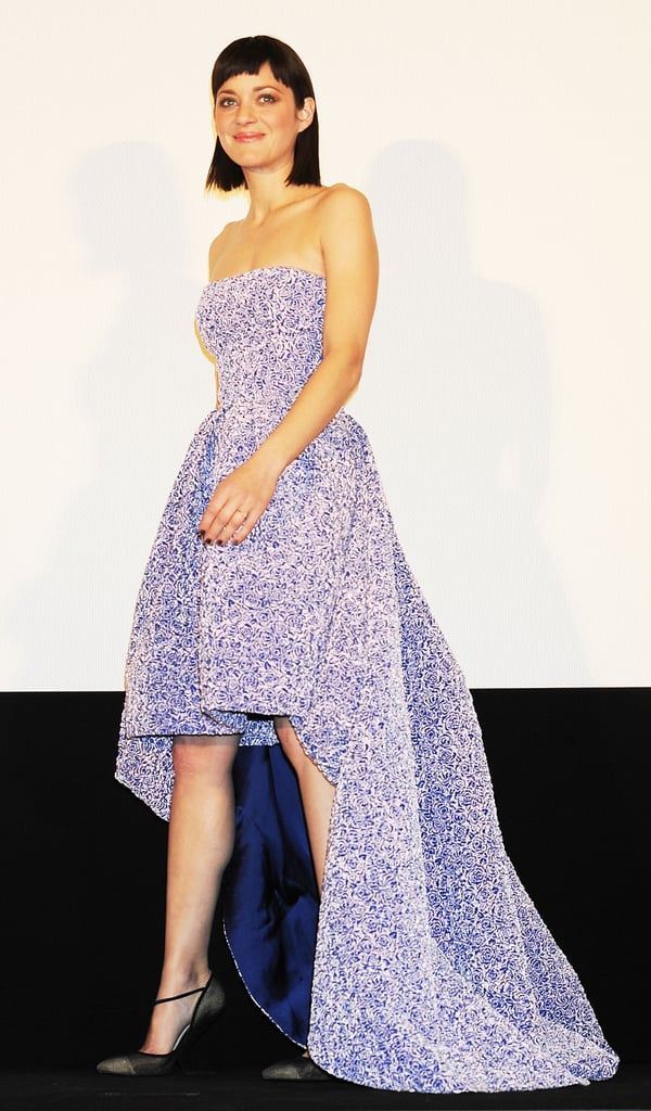 Marion Cotillard took to the red carpet today in Japan for the Tokyo premiere of her film Rust and Bone. Marion also debuted her edgy new fringe haircut at the event, where the actress received a bouquet of flowers and spoke to the crowd before the film's screening. Marion chose a strapless floral dress from Christian Dior's pre-Fall 2013 collection for the occasion, which is fitting since she is the face of Lady Dior. Marion has been linked to the French label since 2008, but this time around, she got hands on with handbags. Dior released a behind-the-scenes video of Marion's creative process while designing her very own carryall, called the 360° Bag.