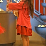 Suri Cruise held her baby-doll while shopping.