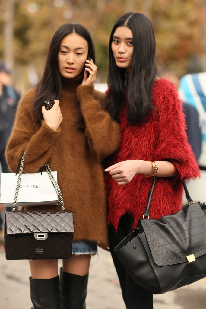 These fashionable friends showed off coordinating mohair sweaters and ultraluxe bags.