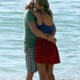 Michael Bublé and Luisana Lopilato hugged on the beach in Australia in March 2011.