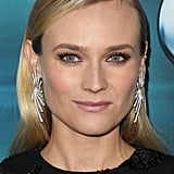 Diane Kruger always knows how to look effortlessly chic. Turn straight hair into a dramatic statement by spraying it at the roots and tucking it behind your ears. It's a quick way to dress up a simple hairstyle. Statement earrings are optional.
