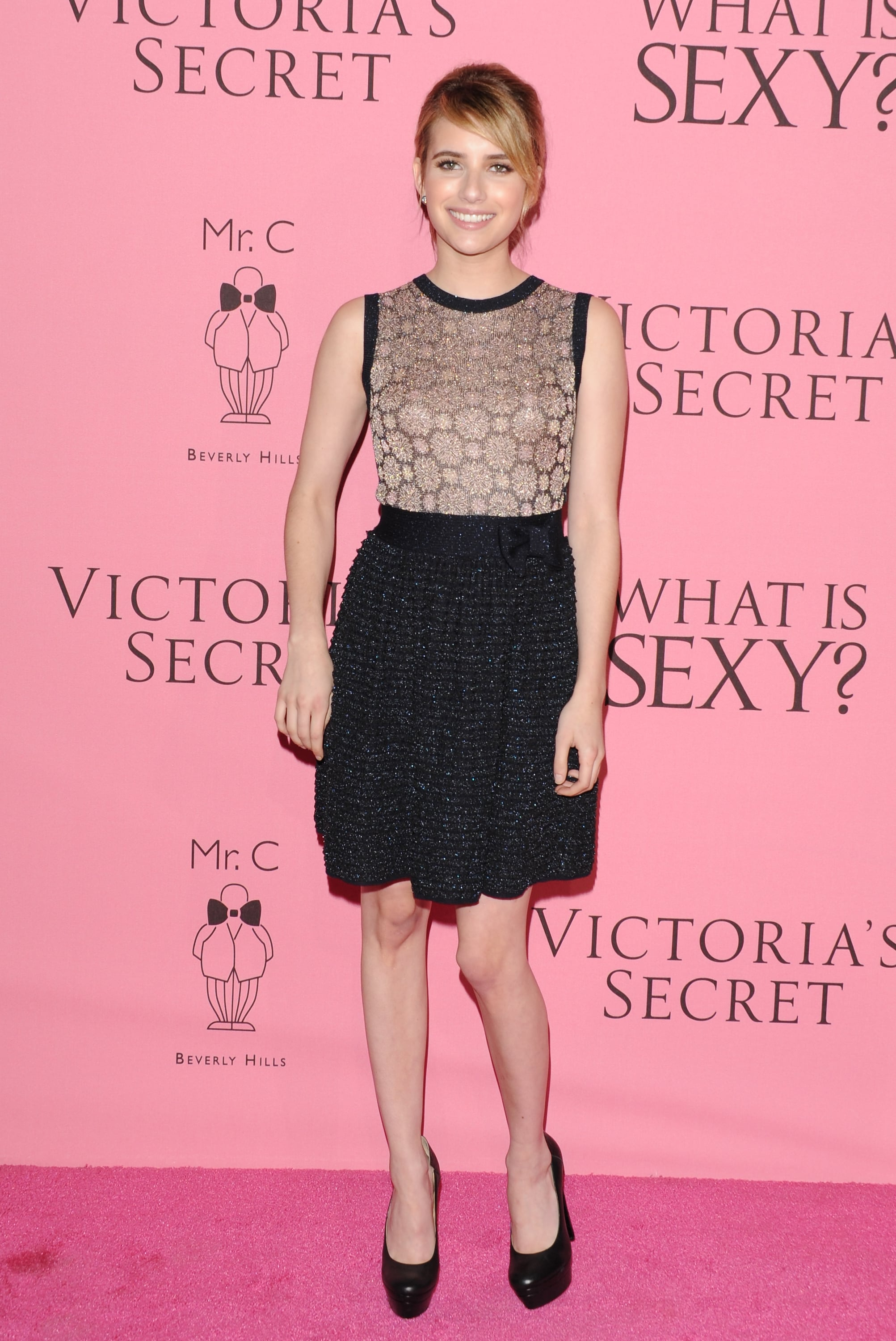 Emma walked the pink carpet at the Victoria's Secret What Is Sexy? party in a flirty cocktail dress in May 2012.