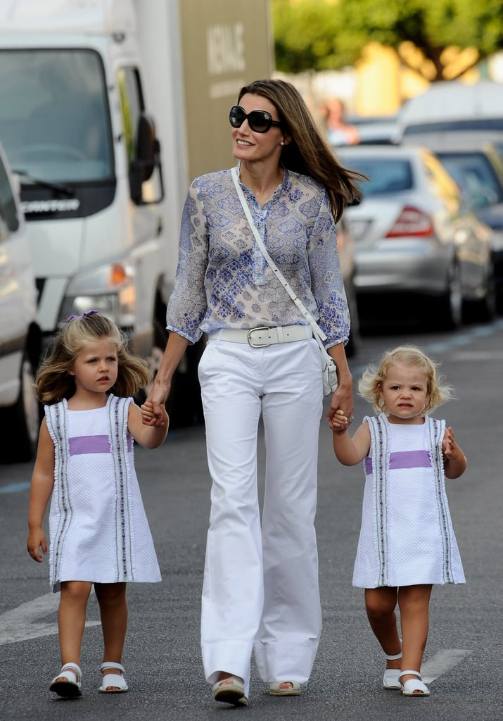 She walked hand in hand with her daughters during the sailing cup in August 2009.