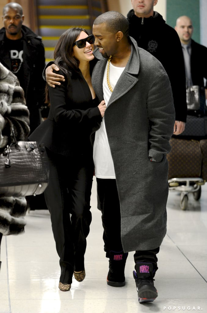"""Kim Kardashian and Kanye West touched down at LAX today. They showed PDA on their way through the airport, where they were joined by Kim's mom, Kris Jenner. Kim and Kanye announced their baby news yesterday, when Kanye introduced his """"baby mama"""" during a concert at Revel in Atlantic City. Kim was reportedly surprised that Kanye chose the venue to reveal the pregnancy, but she quickly confirmed the exciting news with a post on her website, saying, """"It's true!! Kanye and I are expecting a baby. We feel so blessed and lucky and wish that in addition to both of our families, his mom and my dad could be here to celebrate this special time with us. Looking forward to great new beginnings in 2013 and to starting a family. Happy New Year!"""" Kim will be able to celebrate tonight, since she's set to make an appearance at Las Vegas's 1 Oak club to ring in 2013. We're marking the announcement with a look back at Kim and Kanye's sweetest moments since they got together earlier this year."""