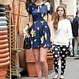 To beat the heat, Taylor slipped into a cute blue-and-yellow floral dress complete with matching headband.