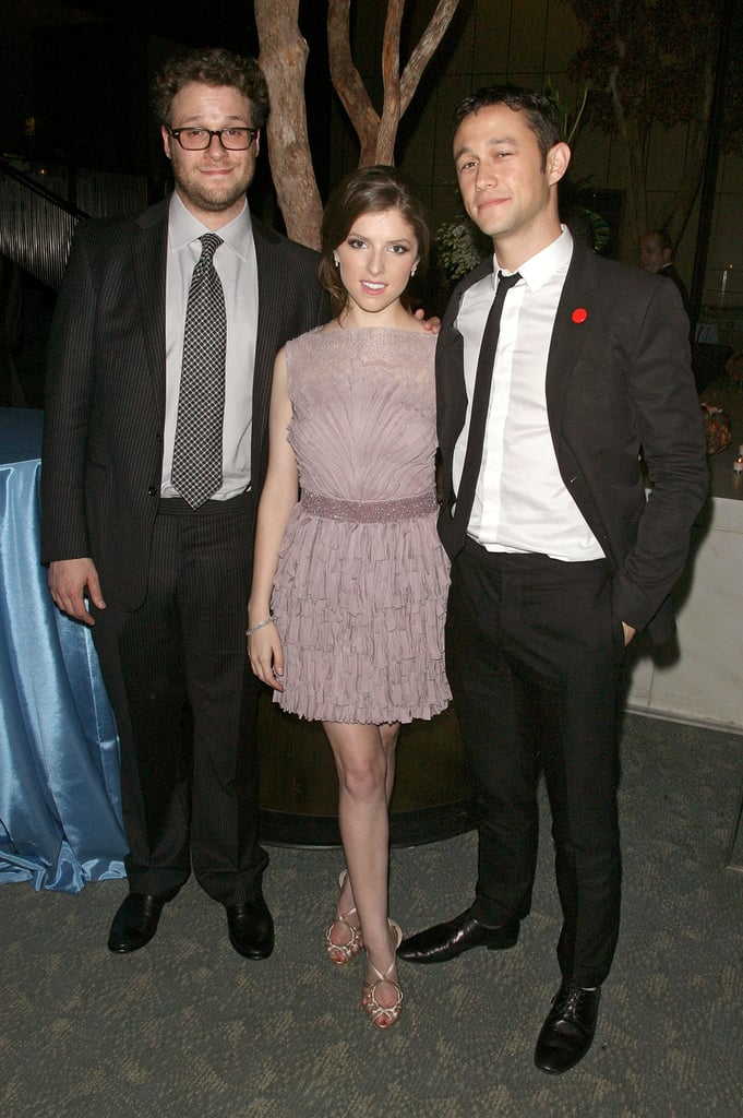 """The stars of 50/50 gathered at NYC's Ziegfeld Theater last night in order to toast their East Coast premiere. Seth Rogen and Joseph Gordon-Levitt posed for photos with Anna Kendrick, who wore a side-swept updo, ahead of the screening, and then reconvened afterward for a bash at the Four Seasons restaurant. It's a big month for Seth, who's rumored to be tying the knot with longtime girlfriend Lauren Miller in the coming weeks. Lauren was on hand for his latest big evening, decked out in a pink plaid dress. Joe was apparently early for the whole affair and tweeted from his car beforehand. He wrote, """"Not allowed to be early to a premiere. So yeah, sitting in a parked car."""" His good humor was also in evidence during the film's junket up in Toronto. We caught a few minutes with the actor, and Joseph dished about The Dark Knight Rises, music, and more."""