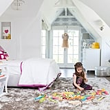 Five-year-old Harper's room is the perfect mix of girlish whimsy and functionality. Serena & Lily bedding, kaleidoscopic Eskayel wallpaper, and a darling window seat set the tone, while beloved books are only an arm's reach away.