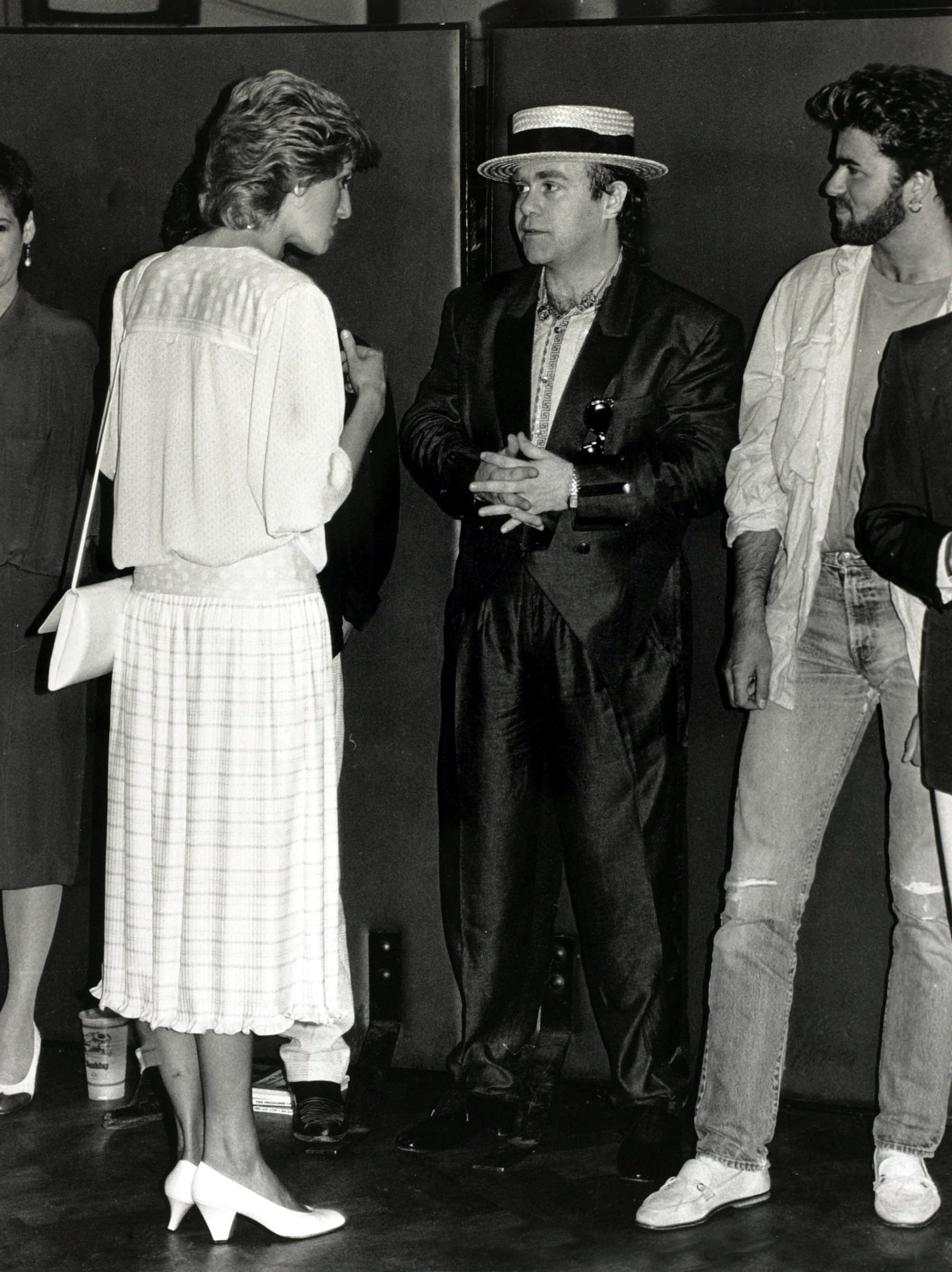 British Royalty, Music, pic: 13th July 1985, Diana, Princess of Wales pictured chatting to musicians Elton John (centre) and George Michael at the