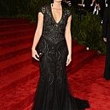 Lauren Bush Lauren went for all black in a plunging Ralph Lauren gown and a matching box clutch.