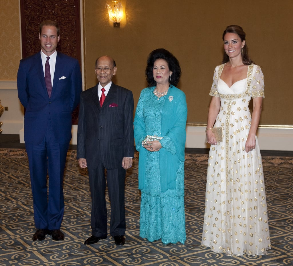 One word: stunning. Kate Middleton stepped out for an official dinner with Malaysia's head of state in a custom Alexander McQueen gown. The white dress, complete with gold embroidered flowers and delicate cap sleeves, provided Kate with the ultimate princess moment.