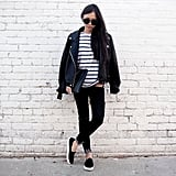 A Striped Top, Black Bottoms, Leather Jacket, and Sneakers