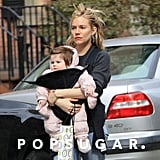 Sienna Miller had her blond locks pulled back from her face.