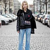 With a leather jacket and luxe flats