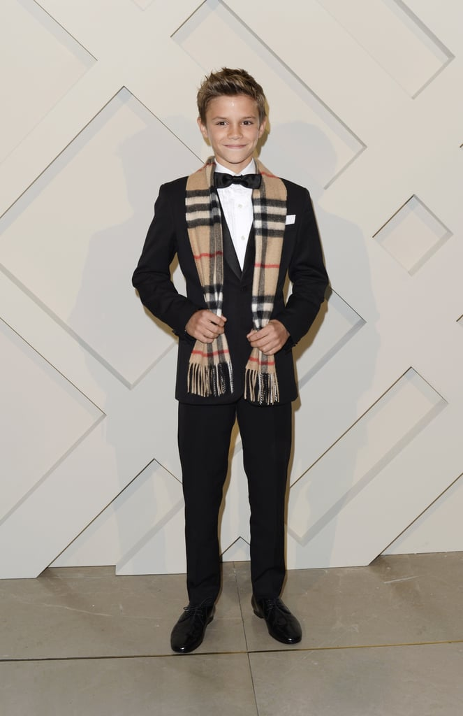 """All eyes were on Romeo Beckham on Monday night when he attended the launch of Burberry's new holiday ad campaign at the brand's Regent Street store in London. The famous 12-year-old, who stars in the new campaign, arrived at the event with his parents, Victoria and David Beckham, but the famous couple avoided the spotlight and allowed Romeo to walk the red carpet solo and soak up all the attention on his own. Romeo is becoming a fixture in Burberry's ads as he's already starred in two campaigns as a young model, and shows off his dancing skills in the most recent video, titled """"From London With Love."""" Of course, he isn't the only up-and-coming model in the family, as his older brother, 15-year-old Brooklyn Beckham, recently landed a three-cover spread in The New York Times's style magazine, T. David has been putting his famous visage to work as well after he starred in the latest TV ad for his new brand of whiskey, Haig Club. Victoria, meanwhile, has been hard at work on her own as she recently opened her first-ever store on London's Dover Street."""
