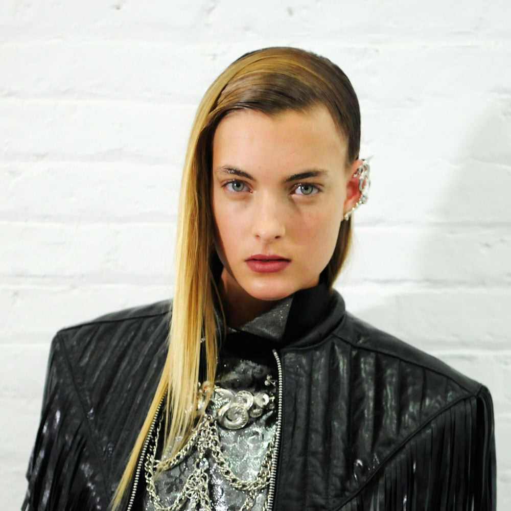 Key makeup artist James Kaliardos gave eyes and lips a wet finish with Nars Triple X lip gloss —even applying it into the eyebrows. To create a smooth complexion, he applied NarsSkin Optimal Brightening Concentrate before dabbing on Radiant Creamy Concealer (out next year) where needed.