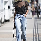 Roomy, raw-edge jeans temper the sweetness of a puff-sleeve top and heels.