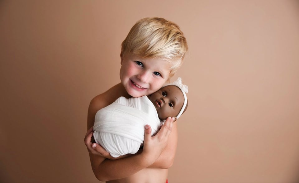 Photo Shoot of a Boy With His Doll