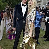 In keeping with The Animal Ball's theme, James Cook and Poppy Delevingne paired their ensembles with feathers.