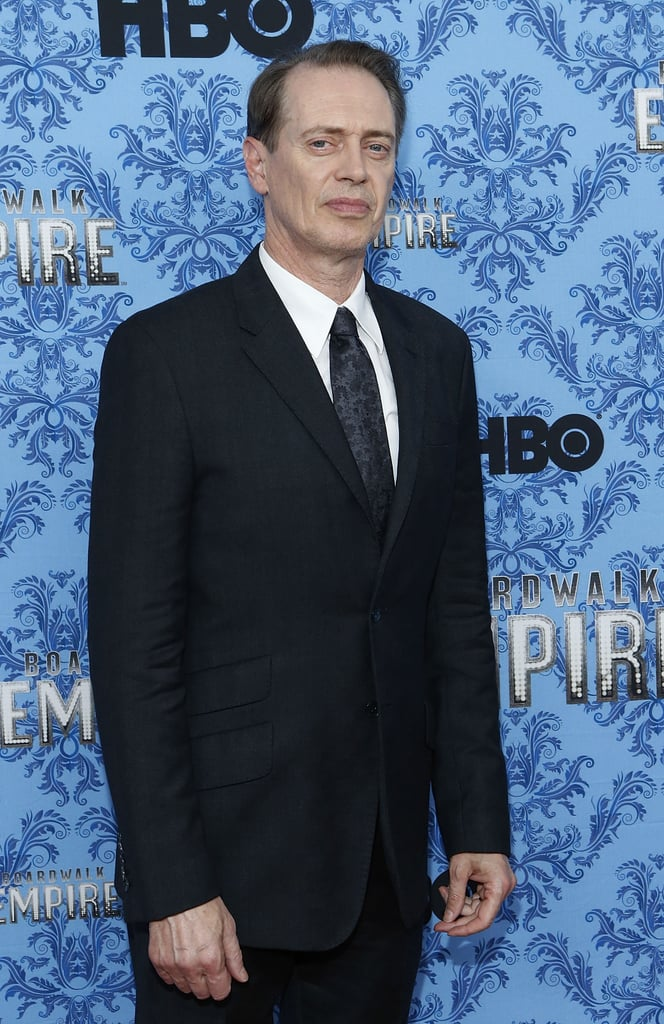 Steve Buscemi posed for a photo in a dark suit.