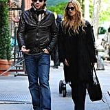 Rachel Zoe and Rodger Berman walked together with baby Skyler in a stroller close behind.