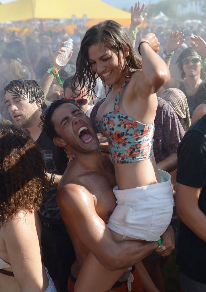 A twosome got wet in the Coachella crowds.
