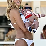 Erin Heatherton played with a baby between takes on the set.
