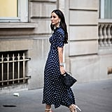 Navy polka dots look great with feminine white heels.
