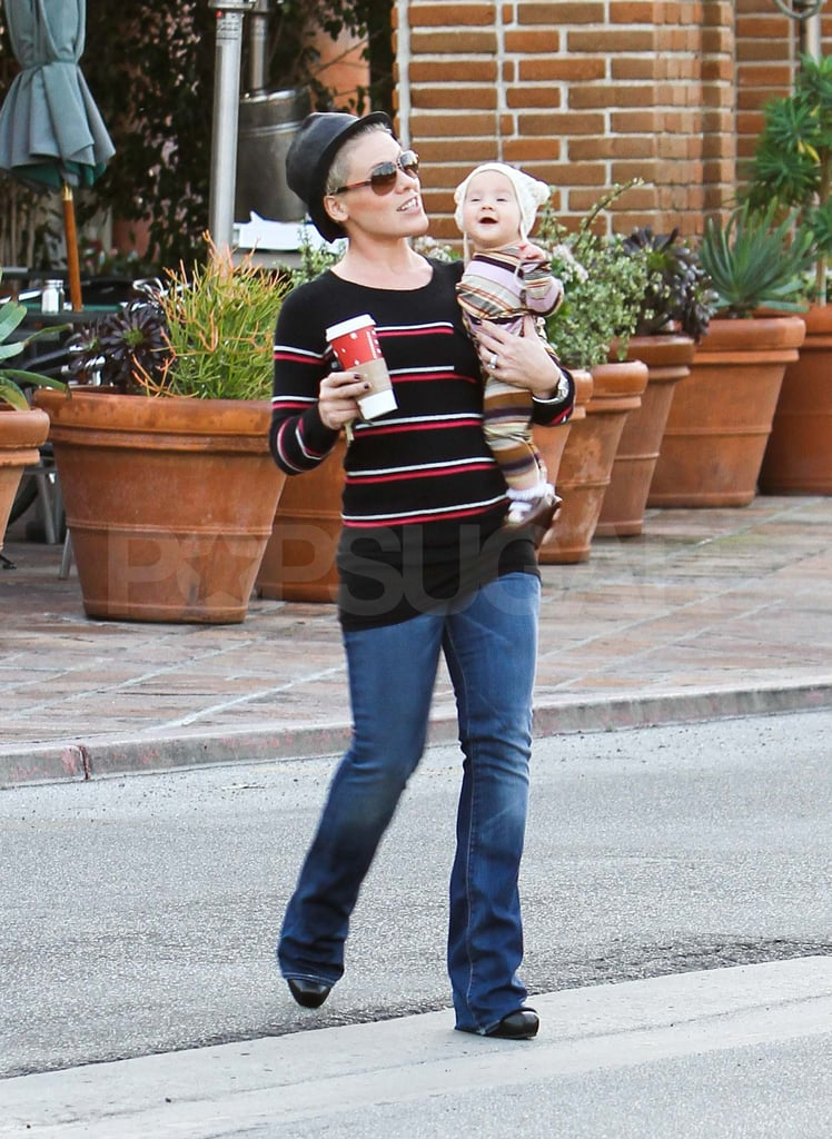 "Pink and her daughter Willow grabbed Starbucks in Malibu yesterday. The twosome wore similar striped outfits and Willow topped off her look with an adorable bear hat. Six-month-old Willow is heading into her first holiday season and her family has already been prepping for the festivities since they picked up their Christmas tree, set up a menorah, and baked cookies last week. The fun doesn't end when the New Year hits, though, since Pink has a big 2012 ahead. She was nominated for a Grammy award for ""F*ckin' Perfect"" and her movie, Thanks For Sharing, will hit theaters."