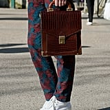 A structured satchel and white shoes melded modern and vintage in one outfit.