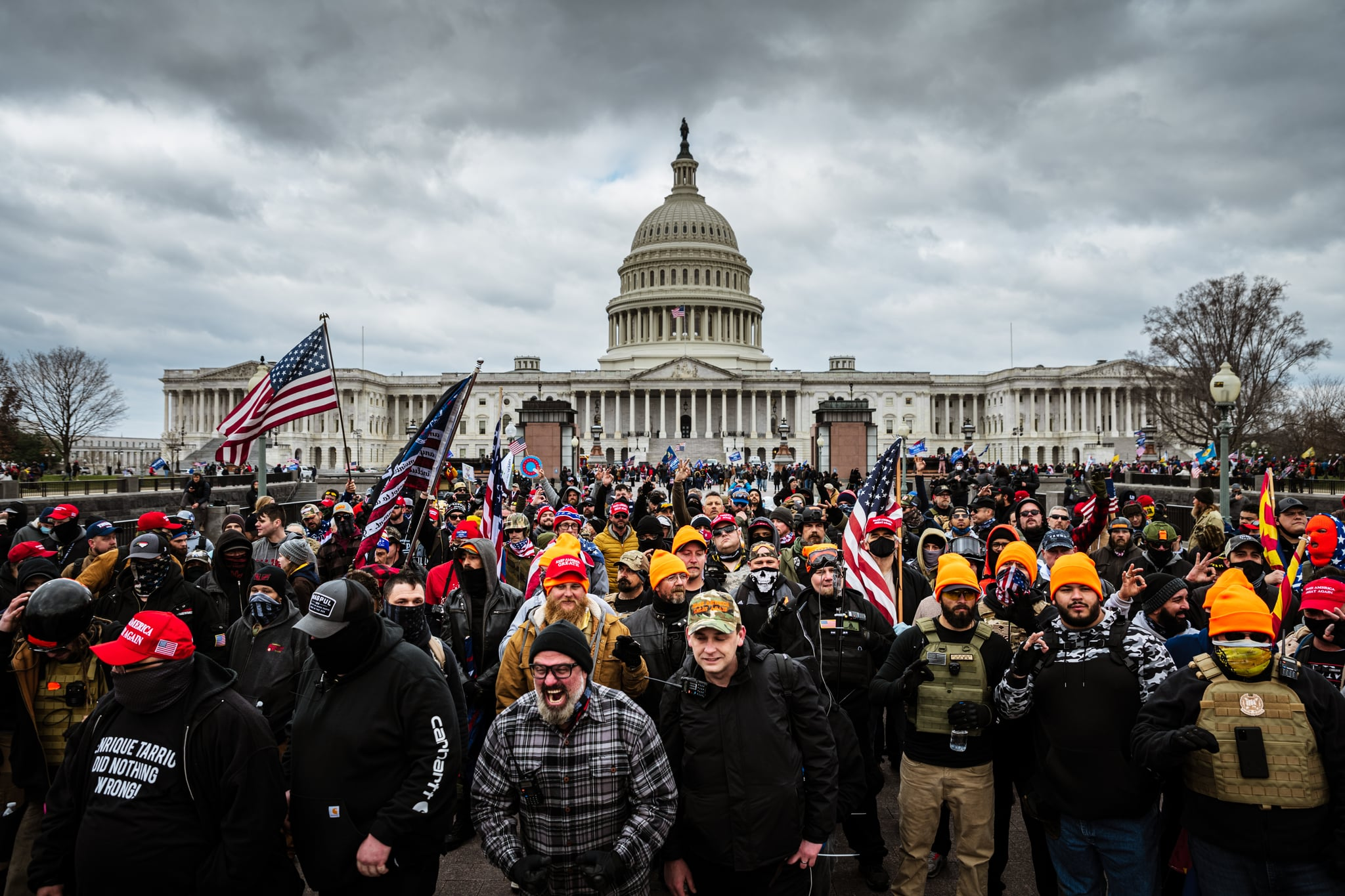 WASHINGTON, DC - JANUARY 06: Pro-Trump protesters gather in front of the U.S. Capitol Building on January 6, 2021 in Washington, DC. A pro-Trump mob stormed the Capitol, breaking windows and clashing with police officers. Trump supporters gathered in the nation's capital today to protest the ratification of President-elect Joe Biden's Electoral College victory over President Trump in the 2020 election. (Photo by Jon Cherry/Getty Images)