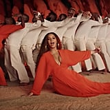 Bey's Bright Orange Pleated Gown
