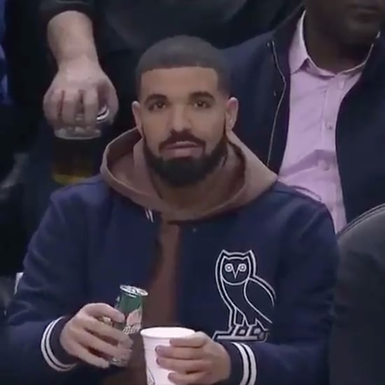 Drake Mixing His Own Drink at Basketball Game