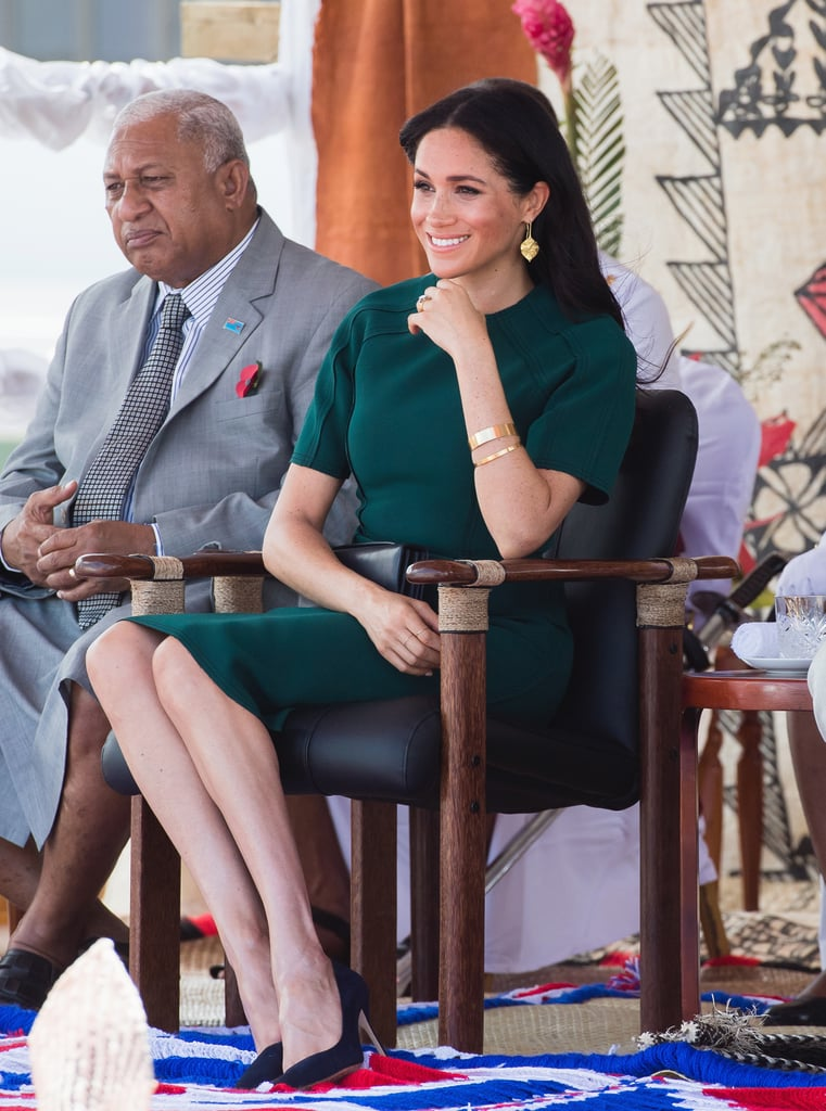 During her 2018 tour with Prince Harry, Meghan wore this emerald Jason Wu sheath dress on a visit to Fiji, styled with Pippa Small earrings and Manolo Blahnik pumps.